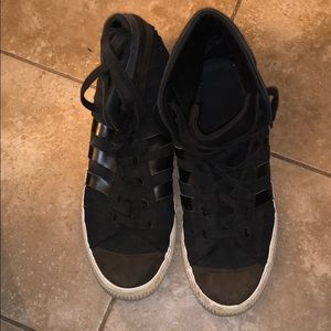 Men's black and brown high top Adidas